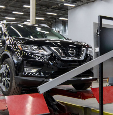 Nissan vehicle on rack for safety calibration